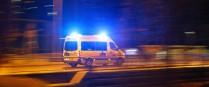 The night shift: emergency ambulance service speeding through the night responding to an emergency call